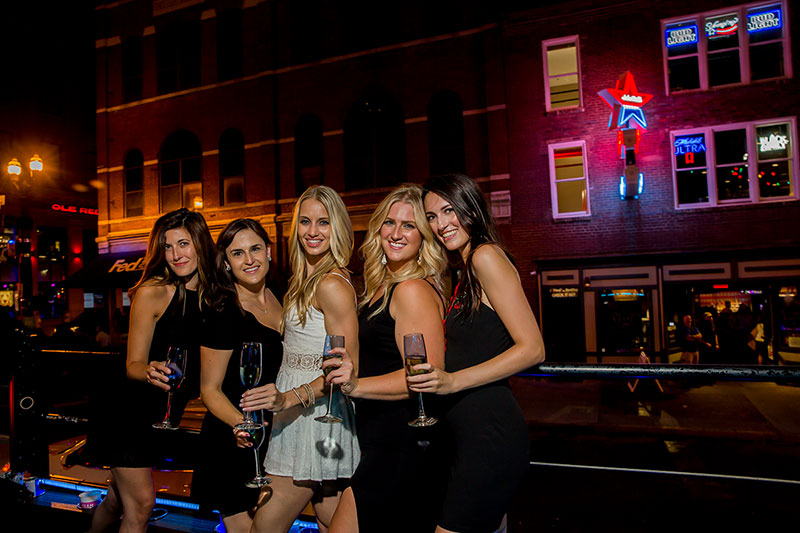 Group of girls on a night out for their Nashville Bachelorette Party on 2nd Street
